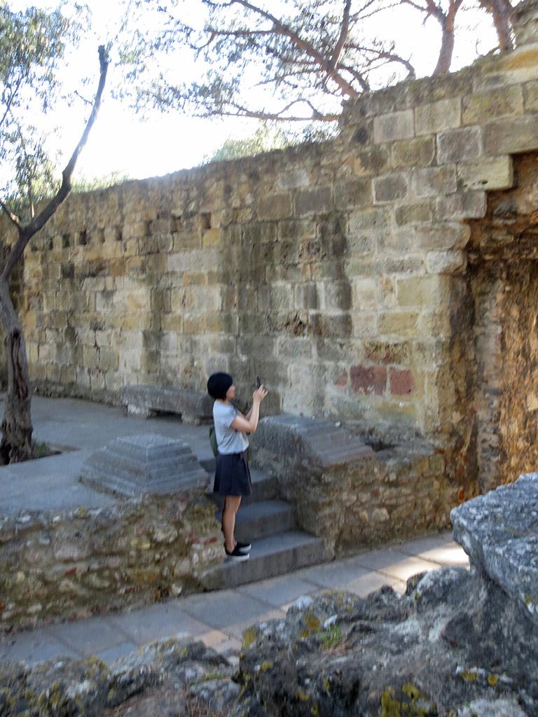 Josie takes a photo of an arch...